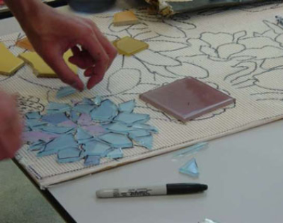 Connie Glover: Making a Community Mosaic 8 meshed glass tiles over tracing paper