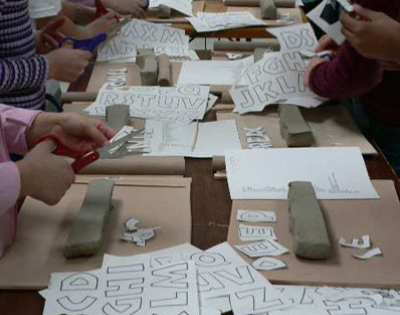 Connie Glover: Making a Community Mosaic 4 paper stencils for lettering