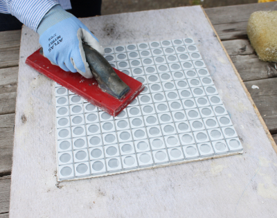 press tile sheet on thinset
